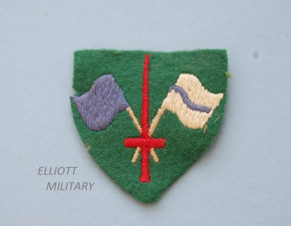 cloth badge showing flags and sword