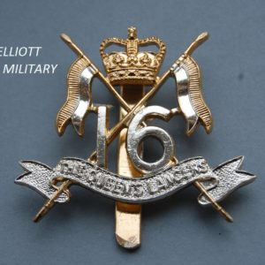 badge with crossed lances, crown and the numerals 16 above a scroll