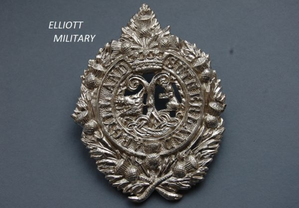 badge with Argyll and Sutherland highlanders crest within a wreath of thistles