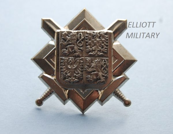 badge with crossed swords under a shield