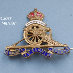 enamel pin badge with field gun and scroll below a crown