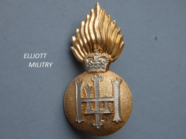 badge with a flaming bomb with lettering HLI below a crown