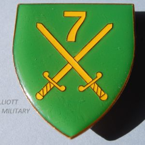 Badge with crossed swords and number 7 on shield