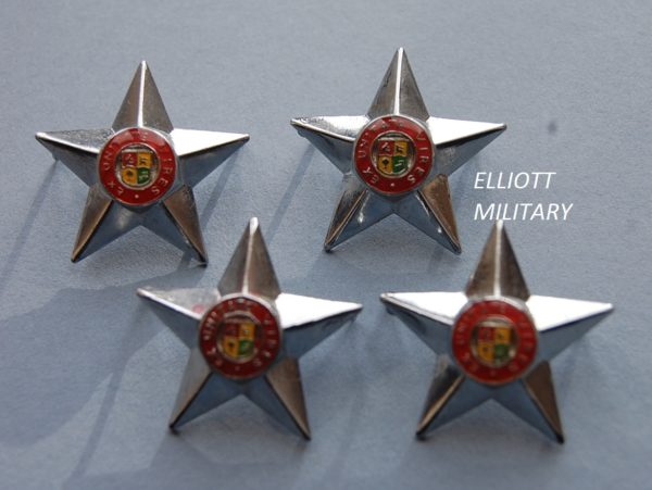 star badges with South African army crest