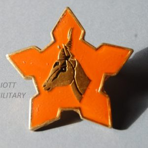 Star shaped badge with gazelles head in the centre