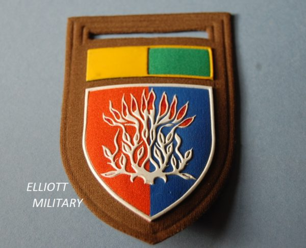 cloth badge with flaming bush on a shield