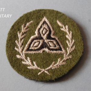 Badge with triangular formation within a wreath