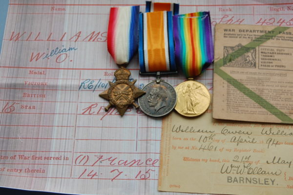 three medals with documents