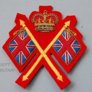 cloth badge with crossed Union Jack flags and crown