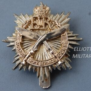 badge with crossed kukri knives on a star below a crown