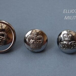 three buttons, two with crowns and the third with letters HMP