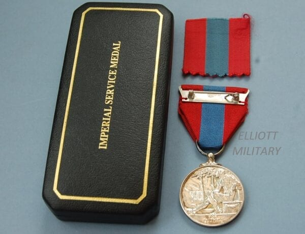 reverse of medal with a seated naked man and the words For Faithful Service
