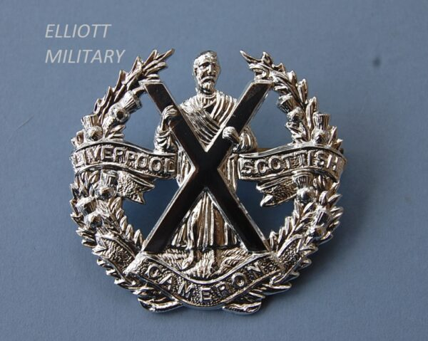 badge with St. Andrew and cross within a thistle wreath and titled scrolls