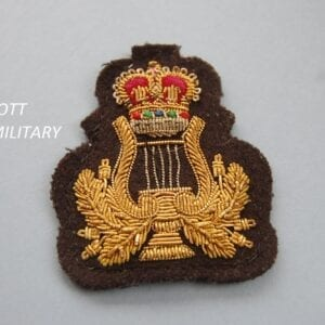 badge with a lyre and leaves below a crown