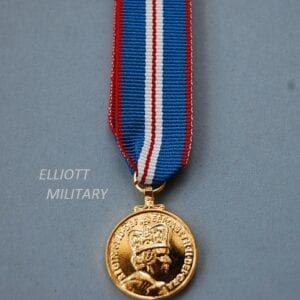 miniature medal with the queens head