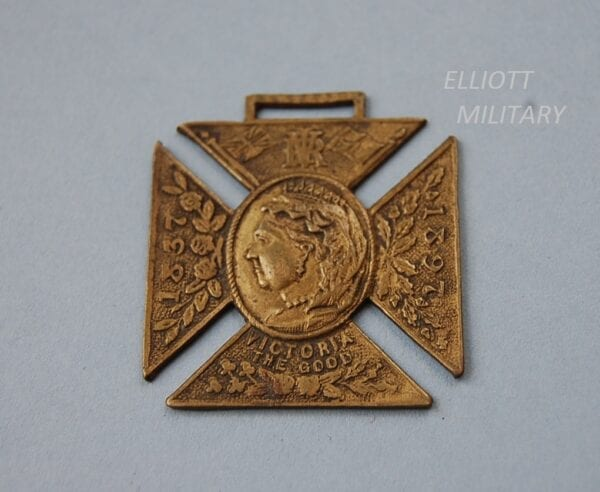 medal in shape of cross with head of Queen Victoria and the dates 1837 - 1897