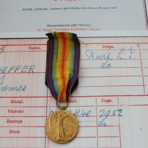 yellow bronze medal showing a winged victory with paperwork