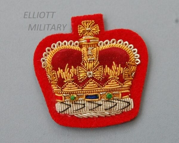 red backed padded cloth badge with wire embroidered crown