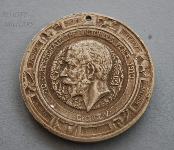 medal with side profile of King George V and the names of allied countries involved in WW1
