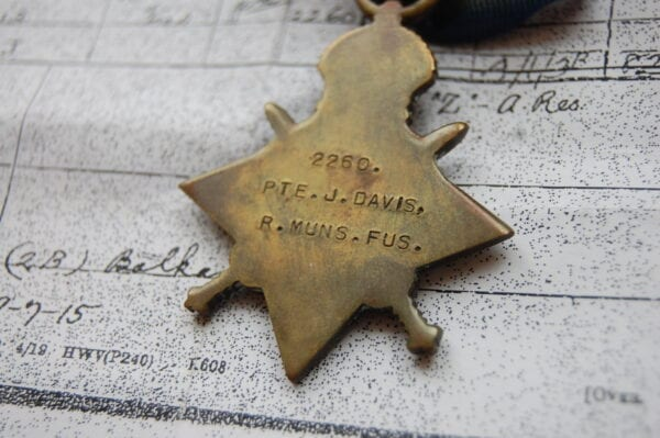 reverse of medal showing recipients details