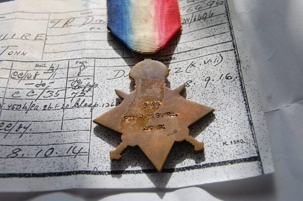reverse of medal showing the naming details