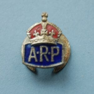 Small buttonhole badge with a crown above the letters ARP on a blue enamel field