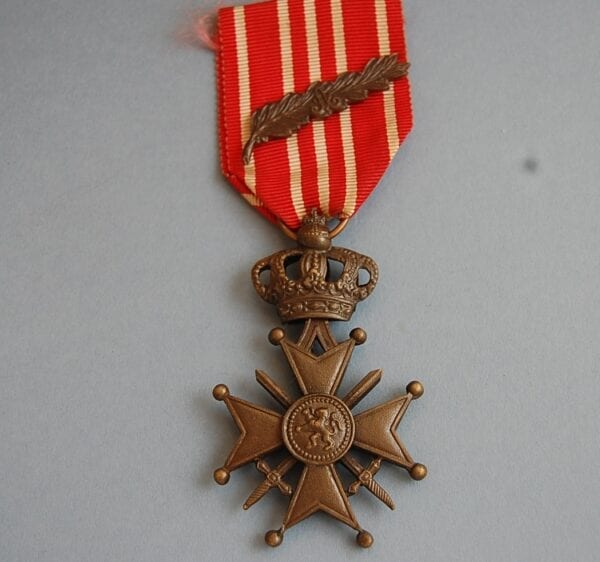 cross with lion below a crown