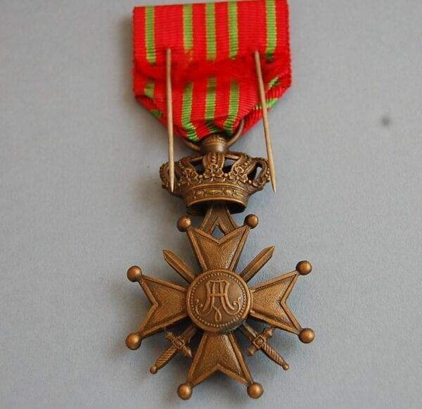 reverse of medal with letter A in centre