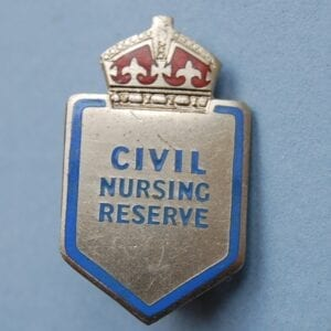 small shield shaped badge with crown above the words CIVIL NURSING RESERVE