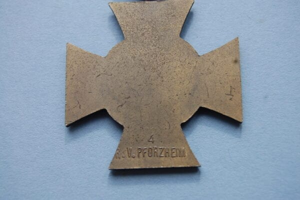 reverse of medal showing makers marks