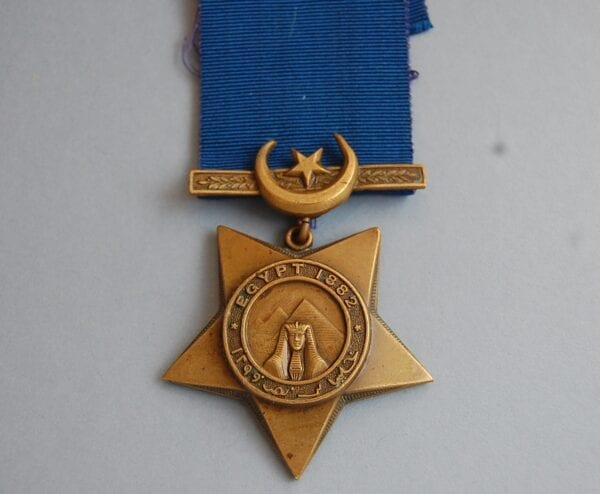 star shaped medal with sphynx and pyramid