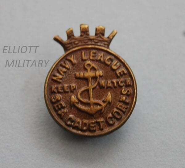 bronze badge with anchor and crown and title