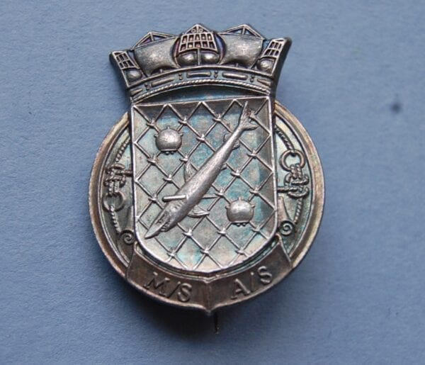 small silver badge with shark in net with sea mines and letters M/S A/S below a naval crown