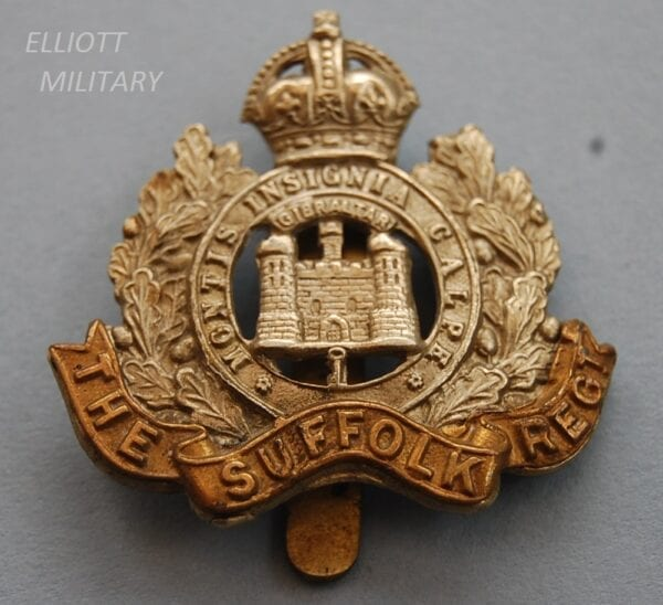 badge with castle and key in scroll within a wreath and Kings crown on top with titled scroll below