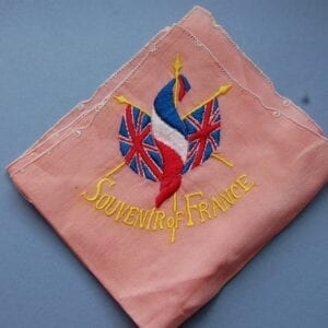 pink handkerchief with crossed British and French flags