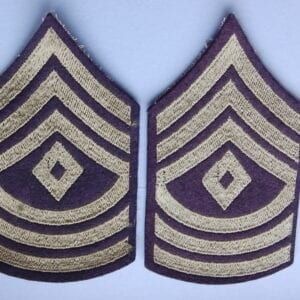 cloth patches with three inverted chevrons above a diamond and three curved stripes