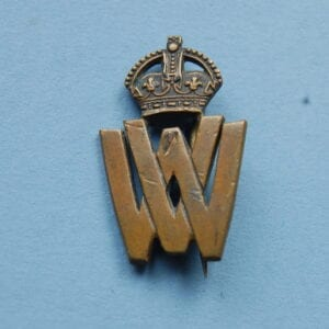 small badge with VW below a crown