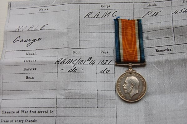silver medal with side profile of King George the 5th
