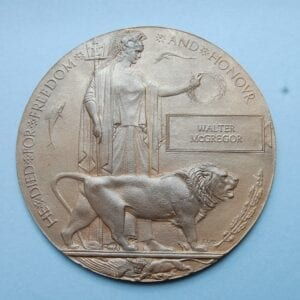 circular bronze plaque with Britania and a lion