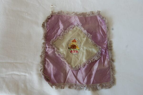 purple silk with Royal Field Artillery gun and crown embroidery