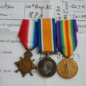 trio of medals with papers