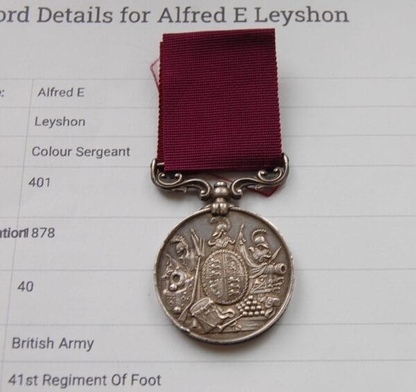 silver medal with crimson ribbon