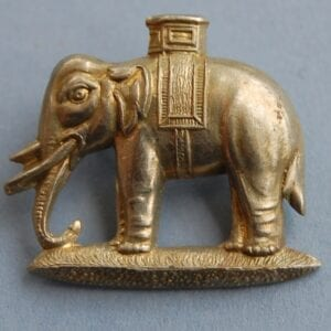 white metal badge with elephant
