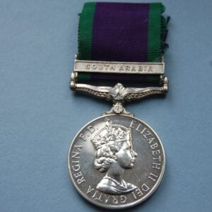 silver medal with Queen Elizabeth 11 profile and bar reading Malaya