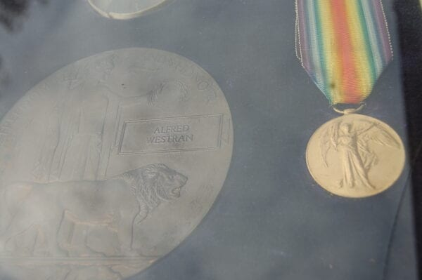 closer photo of Victory medal and plaque
