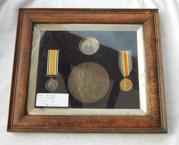 2 medal with plaque and photo in frame