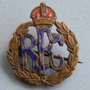 pin badge with letters RFC within a wreath below a crown with red and blue enamel