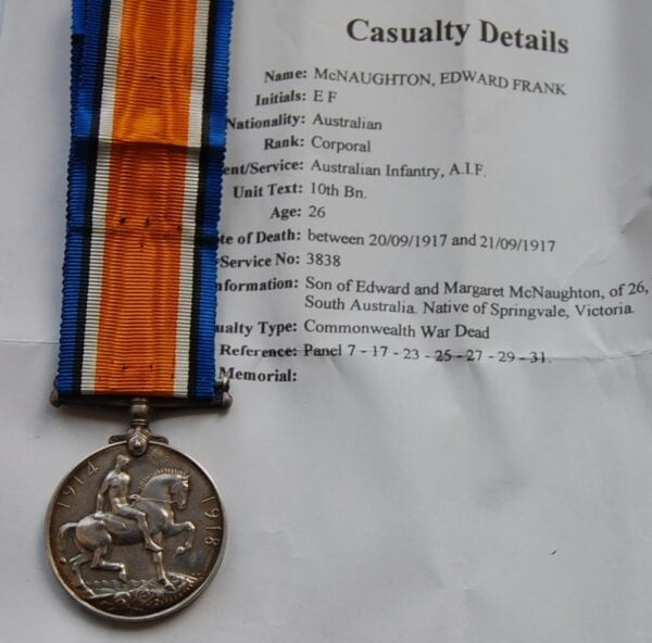 reverse of medal with rider on horse with sword in hand