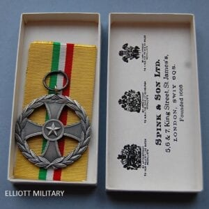 medal with a star within the center of a cross within a wreath
