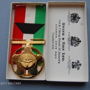gold coloured medal in box
